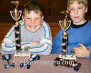 pinewood derby winners with trophy's