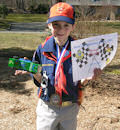 cub scout holding pinewood derby trophy