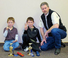 Awana Clubs Father with pinewood derby winners
