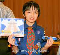 cub scout pinewood derby winner with car