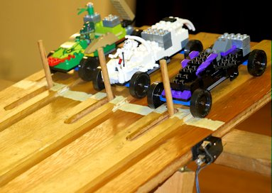 lego derby cars on pinewood derby track