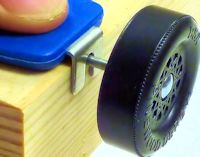 pinewood derby PRO axle guide with axle and wheel
