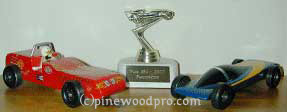first pinewood derby trophy and derby cars picture