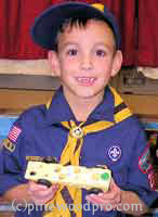 cub scout with Swiss Cheese derby car