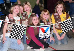 Girl Scouts cheering for Pinewood Derby