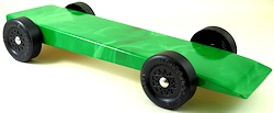 fully built pinewood derby car with green flames body skin