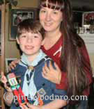 Cub scout with Mom and his pinewood derby car