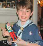 Proud Cub Scout with his Derby Car