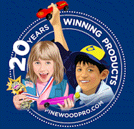boy and girl pinewood derby winner with trophy