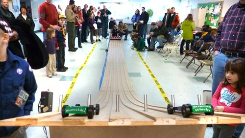 Sandy Hook tribute cars on a pinewood derby track
