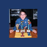 pinewood derby winner with trophies picture