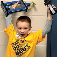 Excited Cub scout who won his Pinewood Derby