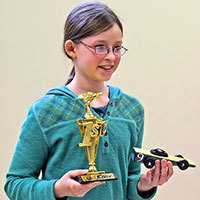 Girl awana racer with car and trophy